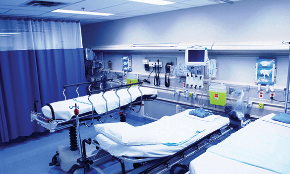 A hospital room with three beds