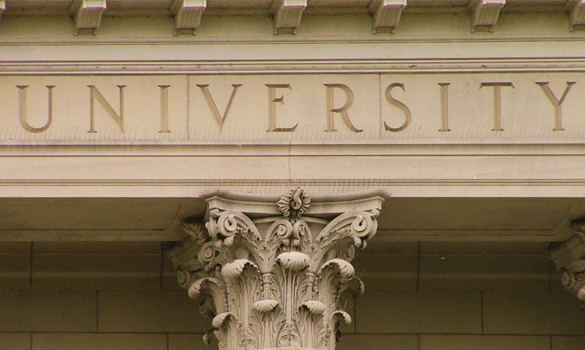 "The word ""university"" engraved into a building above a pillar"