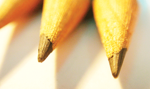 Two lead pencil tips sitting next to each other
