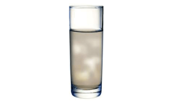 An image of a cloudy glass of water that is contaminated with sediment